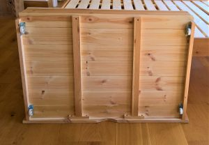 Wooden storage box under bed