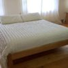 Wooden bed with storage boxes